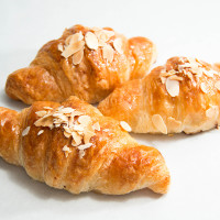 Fresh almond croissant on a white background.